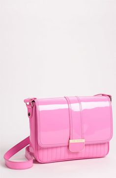 I have an earlier version of this bag in Black! Great bag and cute lining. Check it out. Good price too!  Ted Baker London 'Large' Quilted Crossbody Bag available at Nordstrom