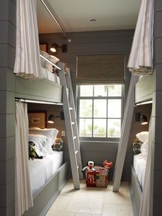 Bunk beds in the boys' room are a great idea! The privacy curtains and sconces are just right for nightly reading.