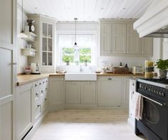light gray cabinet with walnut butcher block | Great Kitchen with Gray Cabinets, Beautiful Stove, Butcher ...