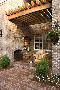 Outdoor living area...great awning #pergolafireplace