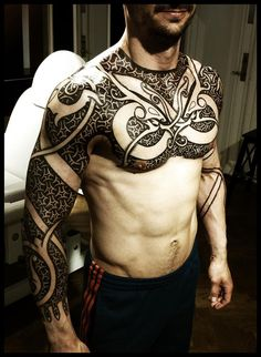 Postive/Negative space blackwork geometric and curvy sleeve/chest piece by Peter Walrus Madsen.