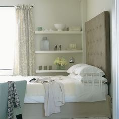 Love the clever addition of wall ledges to maximize space in this small bedroom.