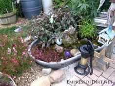Beautiful backyard pond ideas for all budgets | Stock tank converted into garden pond