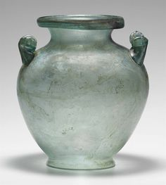 A ROMAN GLASS CINERARY URN CIRCA 1ST-2ND CENTURY A.D.  | Christie's