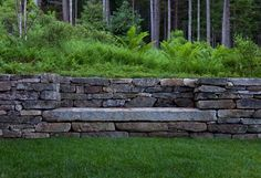 I like the way this stone bench has been built into a retaining wall.