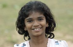 A girl at the Vithiyanandha College Welfare Center in Mulliyavalai, a village in northern Sri Lanka. Once used as a school, this facility now serves as a temporary home to 1850 people displaced by the tsunami of 26 December 2004; this number includes 15 orphans and 129 children that lost at least one parent as a result of the tsunami. 15 January 2005.  Mulliyavalai, Sri Lanka.