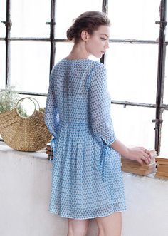 Floaty and relaxed, this mini dress features a flared silhouette and a round neckline with front buttoned slit. The sleeves are finished with self-tie bows. It is ideal for vacation or a hot weekend in the city. Blue Dresses, It Is Finished, Neckline, Bows, Silhouette, Tie, Vacation, Casual, Summer