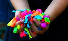 hands full of balloons