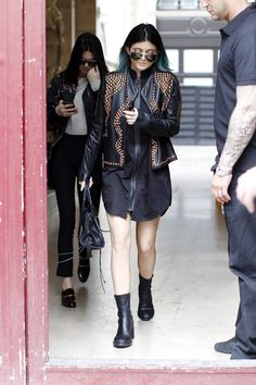 May 20, 2014 - Kendall and Kylie Jenner leaving Kim Kardashian's apartment in Paris