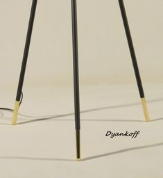Handmade tripod floor lamp with black colored metal stand and gold/brass plated edges of the legs,drum lampshade,Model Vesi XXL Gold Edition