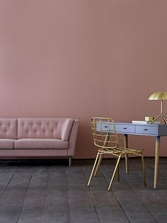 pink sofa, grey/blue desk and gold chair. All furniture available from Out There Interiors