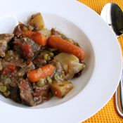 Five Hour Oven Stew  2 lbs. stew meat  3-4 medium potatoes, cut into chunks   2 or 3 handfuls baby carrots  2-3 stalks celery, sliced  1 onion, cut into chunks  1 small can diced tomatoes  2-3 beef boullion cubes  3 T. tapioca  2 T. brown sugar  Salt, pepper, garlic n spices to taste  1 c. frozen peas-add after 4hrs.  Put all ingredients, except peas, in a greased, covered oven proof casserole or pan.  Mix well. Place lid on pan and cook @250 for 4hrs.  Add peas; cook 30 mins more.