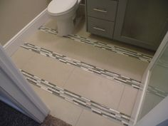 Old World Stone Imports  Modern Porcelain and Glass Bathroom Floor  www.OldWorldStoneImports.com