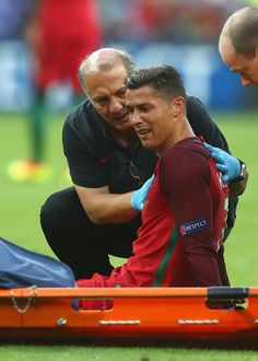 Cristiano Ronaldo of Portugal shows his emotion before being taken off by a stretcher due to injury during the UEFA EURO 2016 Final match between. Cristiano Ronaldo Portugal, Cristiano Ronaldo Cr7, World Football, Sport Football, Portugal National Football Team, Ronaldo Photos, Cristano Ronaldo, Uefa Euro 2016, We Are The Champions