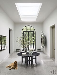 In the central hall of a Northern California home designed by Steven Volpe and renovated by Butler Armsden Architects, the skylight brightens an Ado Chale table from Hedge. The owner& golden retriever lies on a floor of limestone. Design Entrée, Flur Design, House Design, Interior Design, Design Ideas, Design Room, Hall Interior, Hall Design, Interior Colors