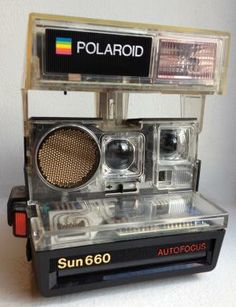 The Polaroid Sun 660 Autofocus camera was first released in See-through version! Polaroid Instant Camera, Instant Film Camera, Autofocus Camera, See Through, Vintage Photography, Museum, Sun, Elmo, Cameras