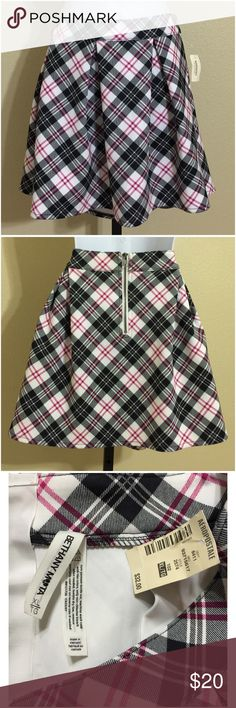 Aeropostale Plaid Skirt Size XL Aeropostale Women's Skirt Size XL Pink, White, & Black Colors Checked Pattern Rear Zip Pleated Machine Washable 92% Polyester 8% Spandex Waist Approx. 34 Inches Hips Approx. 44 Inches Front Length Approx. 16.5 Inches Rear Length Approx. 17 Inches Sweep Approx. 62 Inches Compare Measurements To Your Own Well Fitting Garment To Ensure A Great Fit New With Tag Aeropostale Skirts A-Line or Full