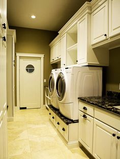 Laundry room.  Like shelving with cabinets on either side.