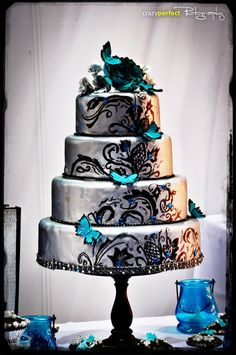 Silver and teal butterflies wedding cake