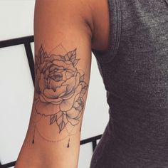 Love the rose and the placement, minus the dotted lines and dangly things.