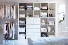 idea--whole ikea kallax or expedit 4x4 with a 1 x 4 added at top for Ali's side of closet!