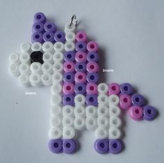 Unicorn pendant Made with beads (Hama) For necklace or to put on a keychain size approx x cm Another model or color on request/order Easy Perler Bead Patterns, Melty Bead Patterns, Diy Perler Beads, Perler Bead Art, Pearler Beads, Fuse Beads, Beading Patterns, Art Perle, Hama Beads Design