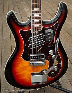 1970 Silvertone 1445L Mosrite Guitar, Flamed Sunburst Maple, German Carved Body and 3-pickups.