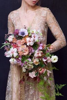 cascading wedding bouquets with greens and gentle pink and purple flowers kiana underwood via instagram