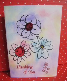 Handmade Card Thinking of You with three flowers with pastel coloured background