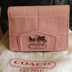 """Gorgeous Coach Wallet! Authentic Authentic Coach Wallet in a lovely dusty pink. Approx. 5x5"""".  Used once in pristine condition. Holds money, change, and 5 slots for credit cards/license. Comes with dust bag. Perfect accessory to pop into your purse! Coach Bags Wallets"""