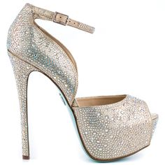 Add the perfect accessory to your big day with the Kiss from Blue by Betsey Johnson.  This sparkling style features a beige fabric upper embellished with shimmery rhinestones through out the entire silhouette.  A sleek ankle strap, 5 1/2 inch stiletto heel and 1 1/2 inch platform complete this special look.