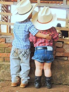 Little cowboy with his arm around his little cowgirl. And, so it began~~~~