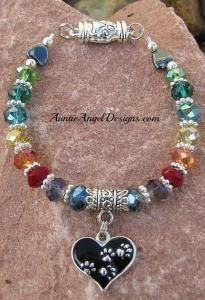 """Meet Me at the Rainbow Bridge"" canine cancer crystal with paw print heart charm tribute bracelet to honor a pet who has passed.  $45.00 includes shipping via First Class mail within the U.S. (only), with a donation to one of our two favorite canine cancer foundations."