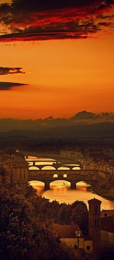 Sunset above the four bridges in Florence Italy