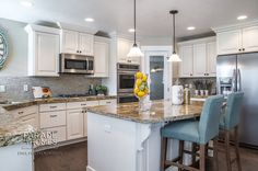white cupboards with light brown granite counters