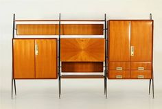 Silvio Cavatorta Highboard | From a unique collection of antique and modern sideboards at https://www.1stdibs.com/furniture/storage-case-pieces/sideboards/
