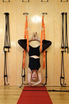 """1 From the front: Rope or Sling """"Headstand"""" with legs in Bound Angle. Letting the body hang quietly. The lumbar releases; a sense of spaciousness increases."""