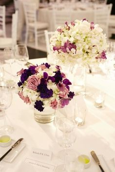 """White and purple flowers led the colour scheme. The bride described her wedding theme as a 'romantic, timeless and chic'.   """"White and purple are my favourite colours and I wanted to keep all the decorations minimal and only use flowers to bring in colour. For the arch, we used white hydrangeas and roses (my favourite flowers), and for the bouquet I wanted something that would go back to the high-low silhouette of my dress. In the end I chose a cascading shape of roses and calla lily. The…"""