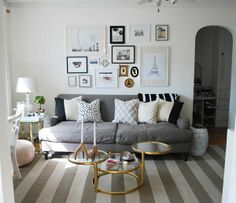 neutral living room, gallery wall, white walls Farrow and Ball Wimborne White, grey english roll arm sofa, striped rug, pink moroccan pouf // styling by Alaina Kaczmarski