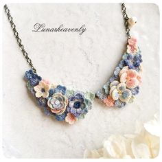 With collar-style necklace. Calm blue of the antique, the pink little. You have to ribbon Marche ♡  # lace  # crochet