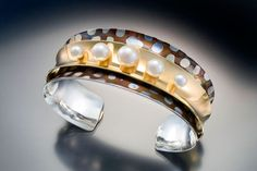 Double anticlastic cuff bracelet. 18K gold, sterling silver, shakudo and pearls.  Photo by Ralph Gabriner.  ||  http://travisrogden.com/TROjewelry.html