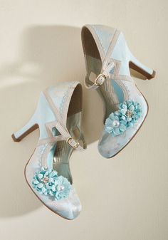 <p>Let your imagination scamper freely while your ensemble joins along with these unique heels by Ruby Shoo! Whimsical and wonderful, these sky blue and metallic champagne Mary Janes flaunt textured seaming, diamond cutouts, brocade accents, and beautiful flower appliques that turn your frolic into a flight of fancy!</p>