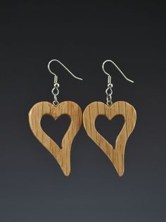 Mark Noll original design, Large Heart Pallet dangle earrings. These lightweight earrings are made from upcycled Pallet wood or other discarded wood. The wood is usually oak, but it might vary. The co
