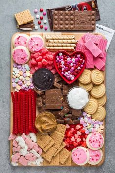 Celebrate Galentine's day with a tasty and festive Galentine's Day Dessert Charcuterie filled with  chocolate, cookies and red and pink candy!