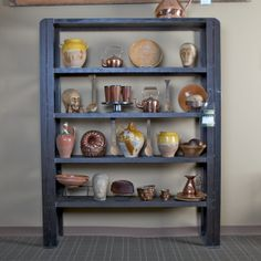 Large Industrial Metal Shelf Unit Item #1939      Price:  $3695     Large French industrial metal shelf unit has four shelves, diagonal side supports and dates from the 1940s.  Accessories shown are sold separately.