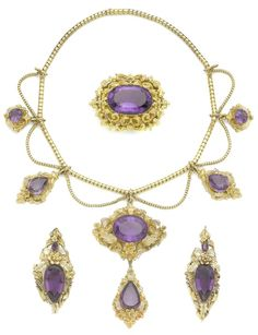 An early 19th century amethyst necklace, buckle and a pair of brooches The snake-link chain suspending similar swags and gold repoussé and cannetille cartouches, centrally-set with circular, oval-cut and pear-shaped amethysts, the largest drop to the centre, accompanied by a buckle and two brooches of similar design