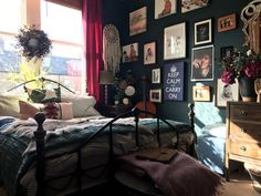 """""""I love to collect art and i am fortunate enough to have high ceilings!"""" The spare bedroom."""