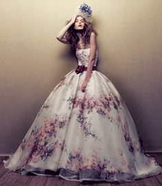 This Floral Print Lace Wedding Dress would be perfect for any spring, summer or garden wedding.