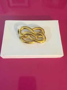 Gold Tone Infinity Brooch by Monet