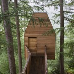 Edinburgh studio Malcolm Fraser Architects have completed this wooden treehouse housing an artists' studio in Glen Nevis, Scotland.